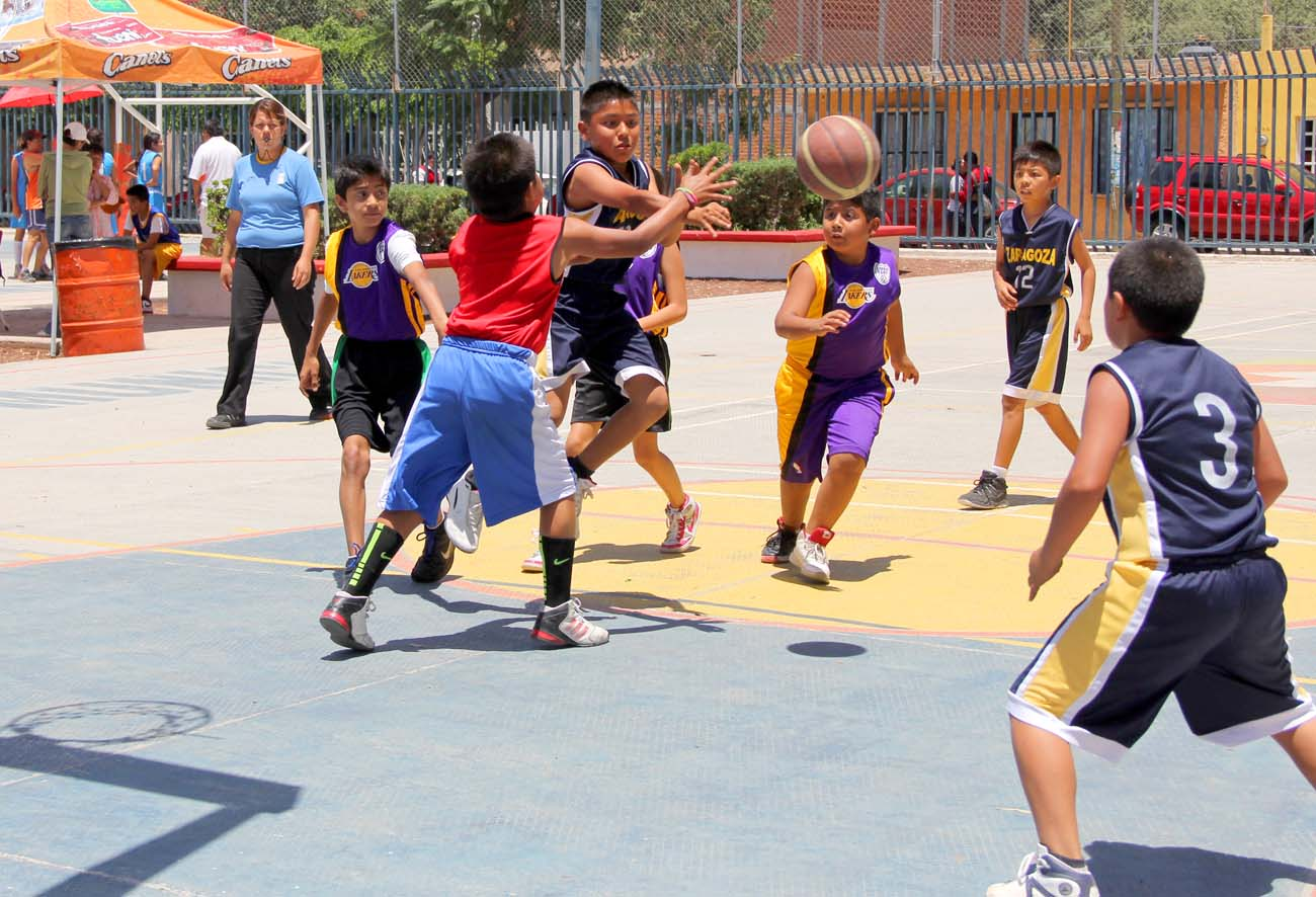 Children playing a friendly game of basketball