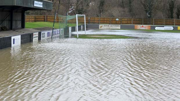severe flooding at a local football ground