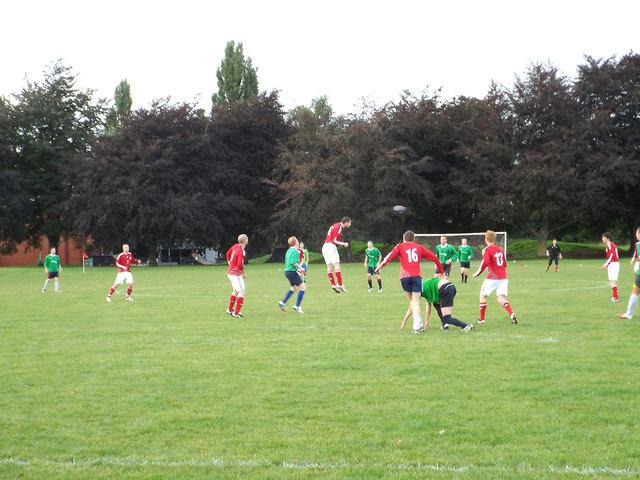 A local football match on a municipal pitch