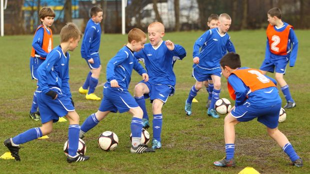 children playing football in the UK
