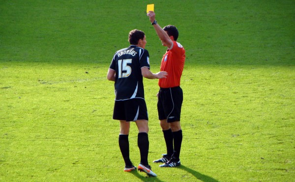 Yellow card given by referee to footballer