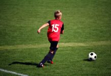 Child playing grassroots football