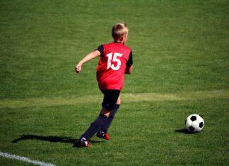 Child playing grassroots football