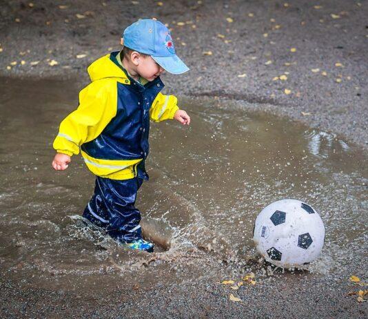 Toddler playing football / soccer